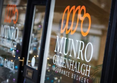 Window graphics Munro Greenhalgh Insurance